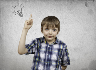 Creative boy with innovative ideas on the background