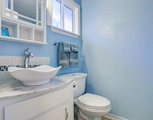Bright bathroom with blue walls.