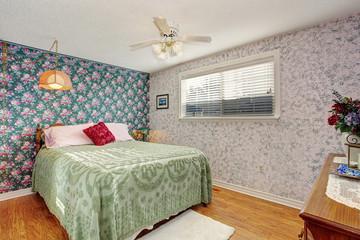 Classic bedroom with hardwood floor.