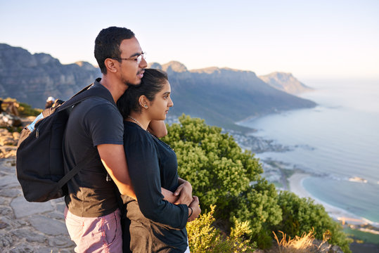 Young Indian couple on a nature hike enjoying the view
