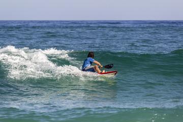 Ocean view and people surfing in Tavira Island beach, Algarve