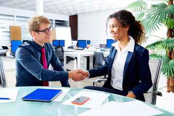 Executive handshake multi ethnic business people