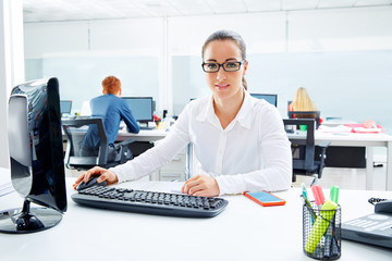 Brunette glasses businesswoman working in office