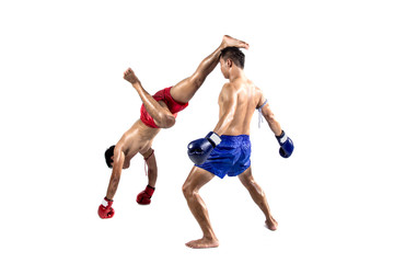 Two thai boxers exercising traditional martial art