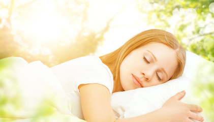 concept of rest and relaxation. woman sleeping in bed on the bac