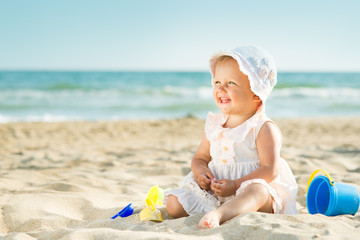 Baby playing at the sea