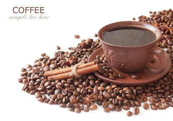 Coffee beans with spice and coffee cup isolated on white