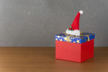 gift box and christmas hat on wood table