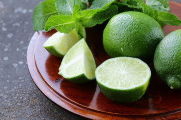 Fresh natural organic green lime with mint leaves