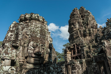 buddha statue inside a prasat in the complex of the bayon in the archaeological angkor thom place in siam reap, cambodia