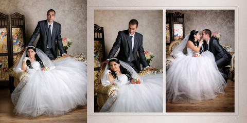 The bride sits in a chair and the groom stands near groom in the room with a beautiful interior