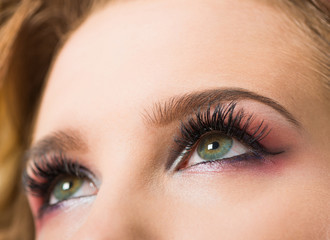 open woman eyes with makeup and long eyelashes