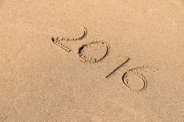 Year 2016 Written On Beach Sand