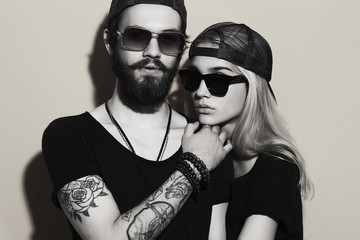 fashion beautiful couple together.Tattoo Hipster boy and girl Wall mural