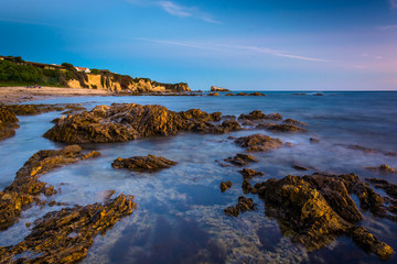 Rocks and tide pools at twilight, at Little Corona Beach, in Cor