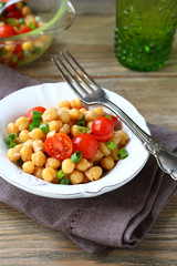 Chickpeas with tomatoes and onions on a plate