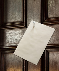 Fototapeta Envelope nailed to wooden door obraz