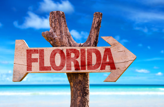 Florida wooden sign with beach background