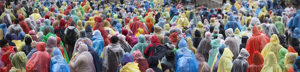 Crowd in colorful raincoats