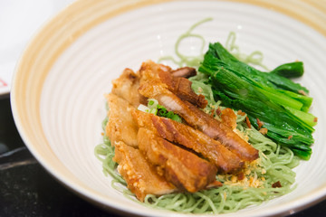 Jade noodle with crispy fried pork chinese hongkong  tradition f