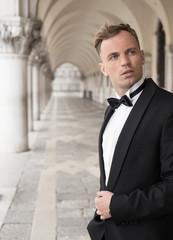 Vertical photo of man in tuxedo