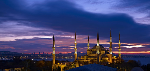 Sultan Ahmed Mosque at sunrise most famous Ottoman Cathedral in Istanbul city illuminated with night spotlight and amazing sunrise sky on background