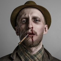 man in a hat with a cigarette