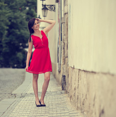 Beautiful brunette girl with red outfit