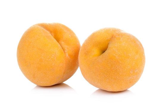 ripe yellow peach on white background