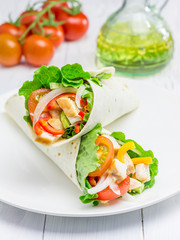 Tortilla wraps with roasted chicken fillet and  fresh vegetables