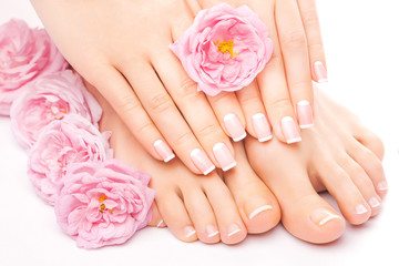 Photo sur Plexiglas Pedicure Relaxing pedicure and manicure with a pink rose flower