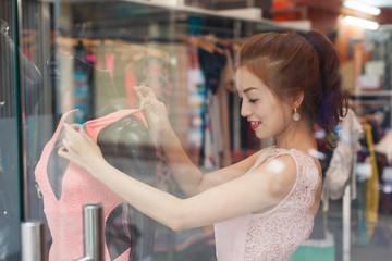 Asian woman shopping choosing fashion dress shop