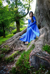 elf princess in roots of big tree