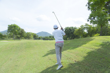 widely golf  course in very nice day summer with player