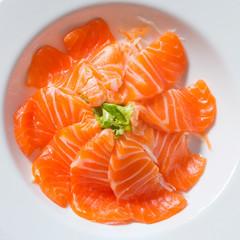 fresh sashimi saimon on wood background