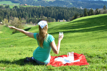 Wall Mural - Jug of milk on the Swiss flag. Emmental, Switzerland