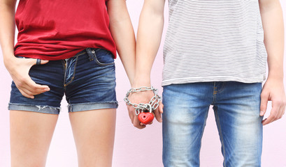 girl friendship boy hand chain fastened heart concept of love forever