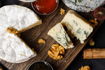 Cheese plate served with  jam and honey