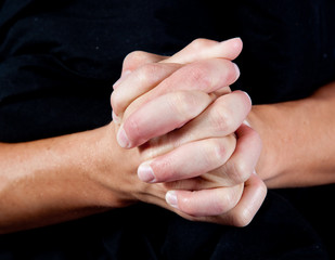 Man's hands clasped together
