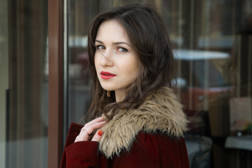 pretty girl in red coat and her expressive eyes