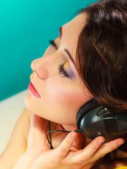 girl in big headphones listening music mp3 relaxing