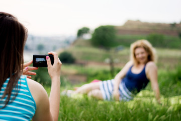 Girl photographing a friend