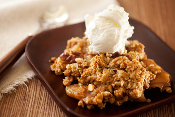 Homemade Hot Apple Crisp & Ice Cream. Cinnamon, oatmeal and walnuts used in the recipe.