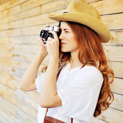 Young woman with retro photo camera outdoor
