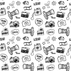 Hand drawn vector photography doodles seamless pattern.