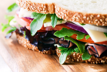 Black Forest Ham Cheese & Vegetable Sandwich. Includes fresh tomato, onion and mesclun lettuce.