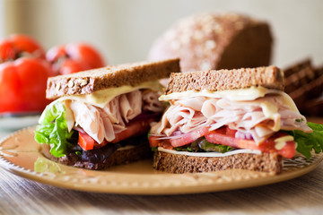 Deli Sandwich - Sliced Roast Turkey, whole grain brea, sliced tomatoes, crisp lettuce, and cheese.