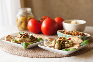 Olive Bruschetta, Hummus Dip on Toasted Pita Wedges