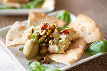 Hummus Dip on Toasted Pita Wedges & Olive Bruschetta with spring onions and fresh basil.