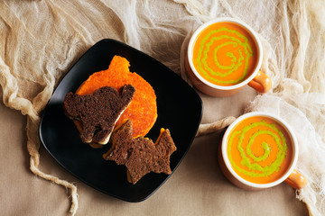 Halloween Grilled Cheese Sandwiches in the shape of a pumpkin, black cat and bat. Witches Brew Soup with pesto swirls.